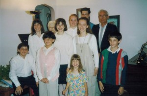 Mom always ends her recitals with a group photograph. This photo is from May 1994. The little girl in the front is me!