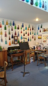 Mom's studio is filled with hundreds of violin bottles. They bring a lot of color into her teaching space.
