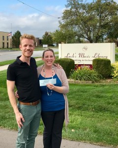 Bryan Kolk (Treasurer, Michigan ASTA Chapter and Troy High School Orchestra Director), Amy King (Sales and Marketing Manager, Luck's Music Library) at the Luck's Music Library Headquarters.  This photo was taken when Bryan Kolk stopped by to drop off a $2,000 donation from the Michigan ASTA Chapter for the Hurricane Harvey Fundraiser.